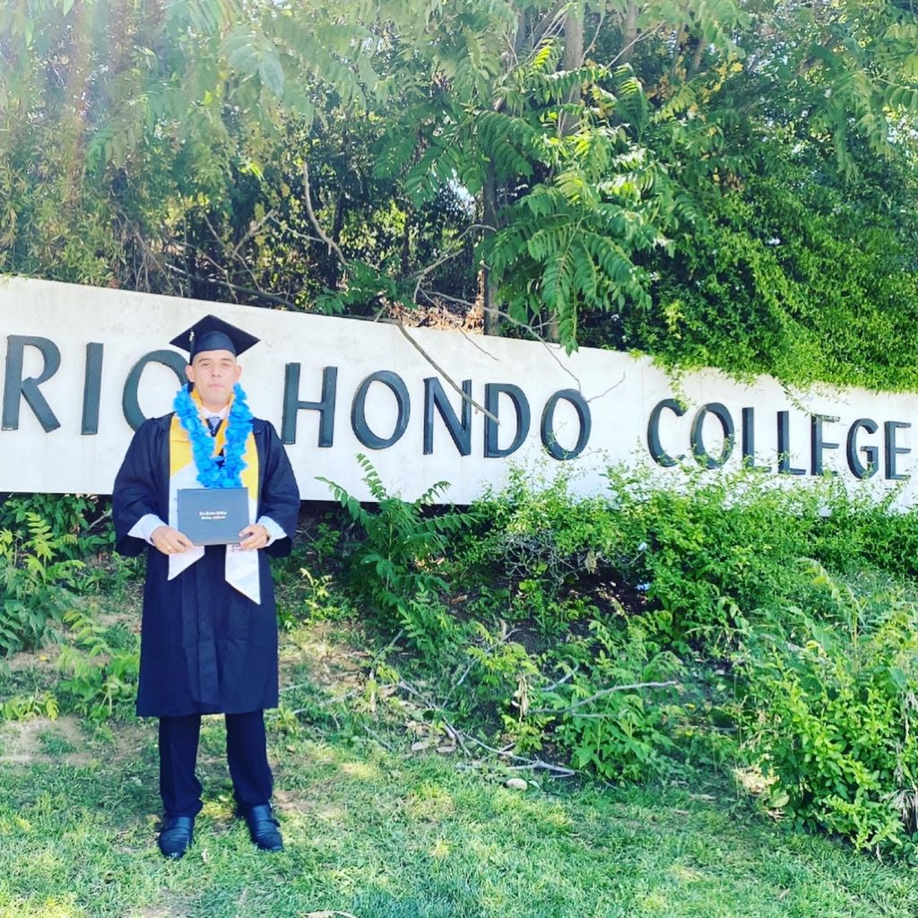 Erick Pineda, Rio Hondo College, pictured wearing Career Readiness Sash as he celebrates graduation
